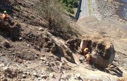 The Abseil Access crew works to clear a 50 tonne boulder at Slip 14